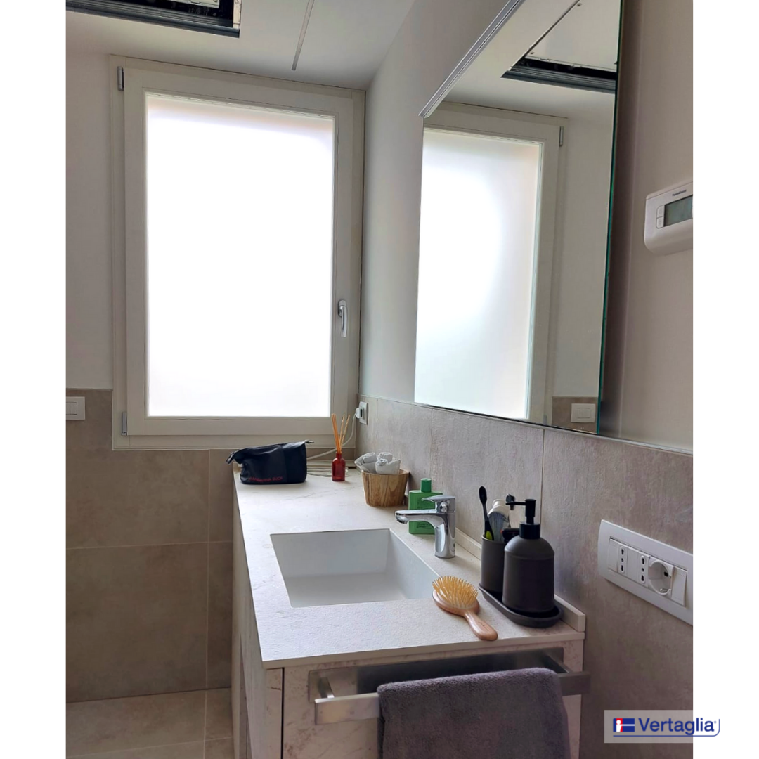 Extralusso RAL 9010 frames for a luxury residence in Cernusco sul Naviglio.